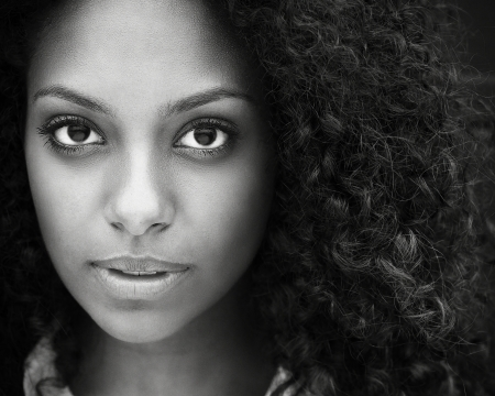 Black and white closeup portrait of a beautiful young woman