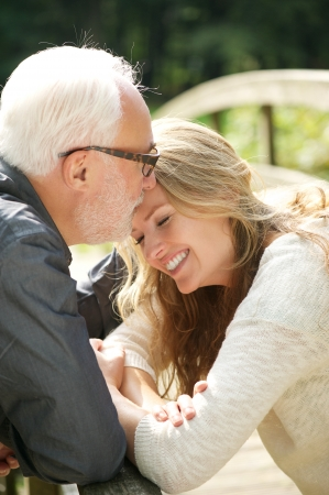 mature woman face: Closeup portrait of a happy daughter standing close to father Stock Photo