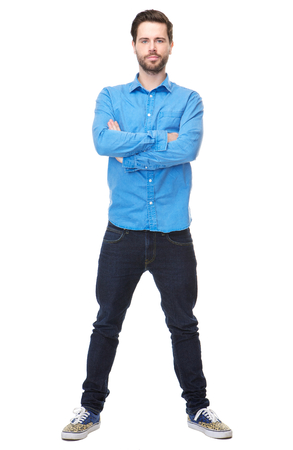 full   length: Full length portrait of a confident young man with beard standing on isolated white with arms crossed