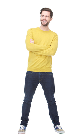 yellow shirt: Full length portrait of a happy man smiling with yellow shirt on isolated white