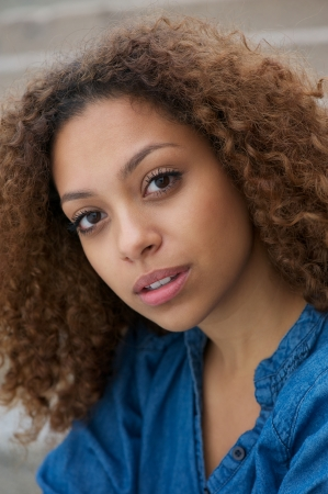 Close up face of a beautiful young woman with curly hair photo
