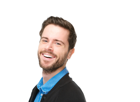 Close up portrait of a charming young man with beard laughing on isolated white background photo
