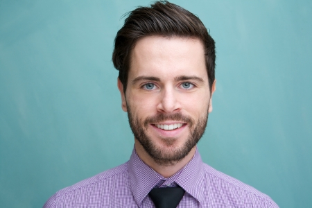 Close up portrait of an attractive young businessman smiling