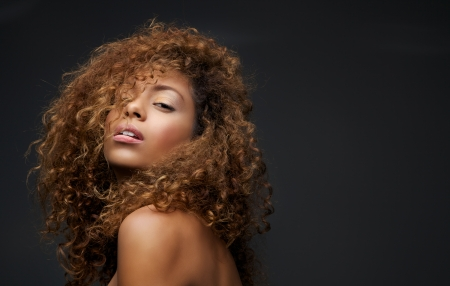 elegance fashion girls look sensuality young: Close up portrait of a beautiful female fashion model with curly hair
