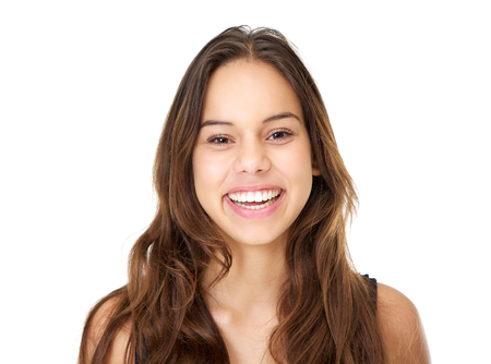 Close up portrait of a smiling young woman with long hair on isolated white background photo