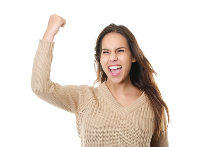 fist pump: Closeup portrait of a successful young woman smiling and celebrating with fist pump