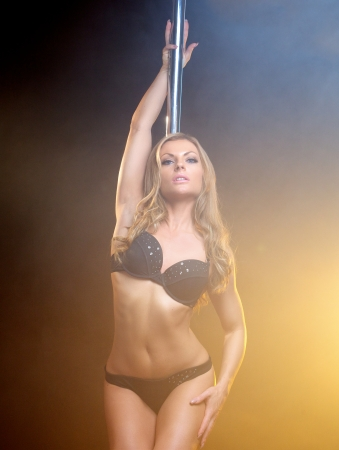 Close up portrait of a beautiful female pole dancer posing in lingerie photo