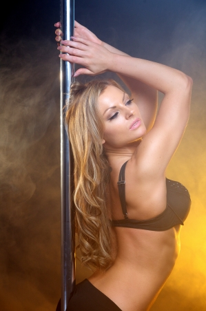Close up sensual portrait of a beautiful woman in lingerie pole dancing Stock Photo