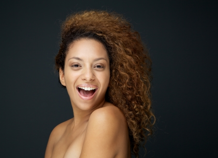 Close up beauty portrait of a attractive woman laughing with curly hair photo