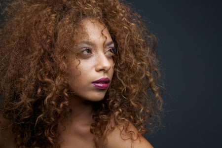 Horizontal portrait of a gorgeous female fashion  model with curly hair photo