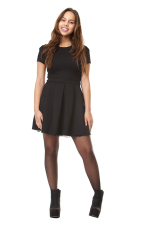 Full body portrait of a happy young woman smiling in black dress