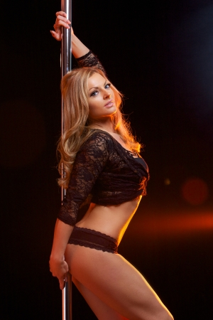 Portrait of a sensual female pole dancer  photo