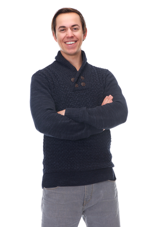 Portrait of an attractive young man smiling with arms crossed on isolated white background photo
