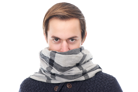 Close up portrait of a young man with scarf covering face photo