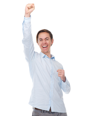 raised: Portrait of a happy cheerful man with arms raised in celebration isolated on white background Stock Photo
