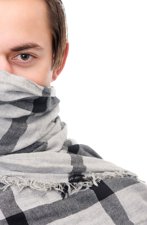 Half face portrait of a male fashion model with scarf covering face isolated on white photo