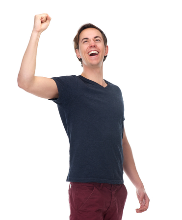 Portrait of a excited young man with arm raised up isolated on white background photo