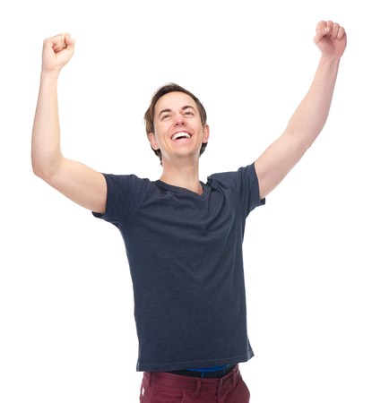 Portrait of a smiling man with arms raised in success isolated on white background