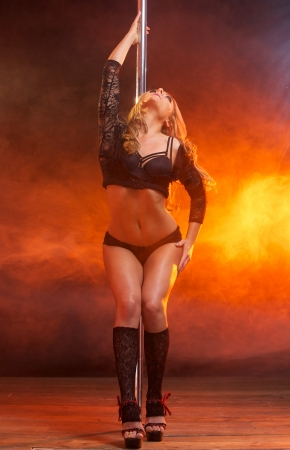 Full body portrait of a beautiful female dancer posing in black underwear photo