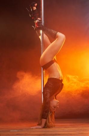 Full body portrait of a sensual female pole dancer