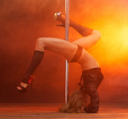 Full body portrait of a beautiful female dancer performing striptease photo