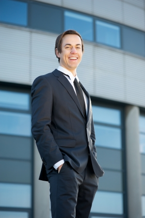 Portrait of a smiling young businessman standing outdoors  photo