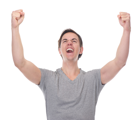Close up portrait of a young man celebrating with open arms isolated on white photo