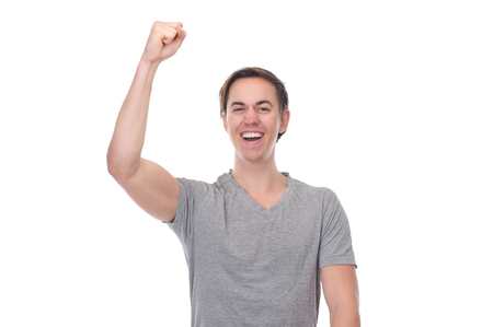 Close up portrait of a man with arm raised up in celebration isolated on white photo