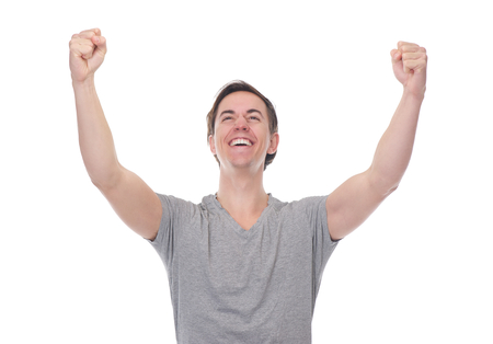 Close up portrait of a man smiling and celebrating with arms outstretched on isolated white background photo