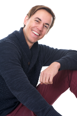 Close up portrait of a happy man smiling on isolated white background photo