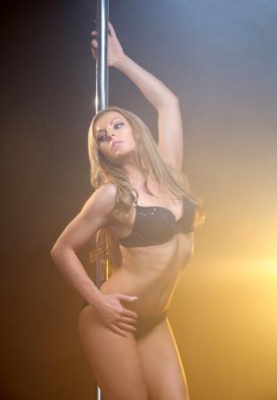 Portrait of a beautiful female dancer with slim body photo