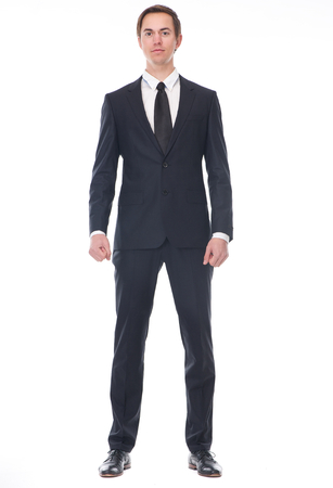 Full body portrait of a businessman in black suit standing on isolated white