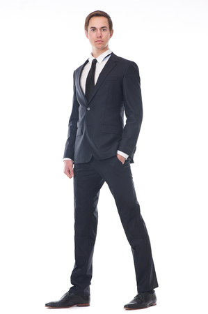 full suit: Full body portrait of a handsome young businessman in black suit isolated on white