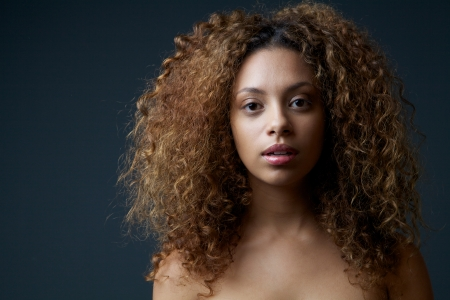 Close up portrait of a beautiful female fashion model with curly hair photo