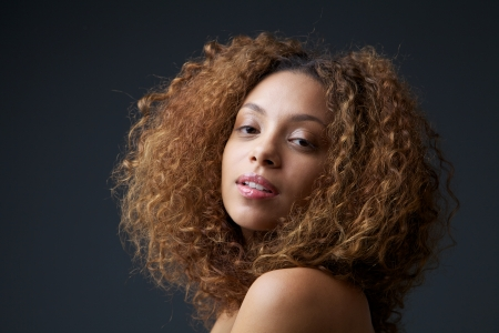 Close up beauty portrait of a pretty young woman with curly hair Stock Photo - 24238507