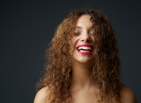 Close up portrait of a young african american woman laughing Stock Photo - 24238508