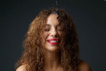 wet hair: Close up portrait of a beautiful african american girl with water dripping down face