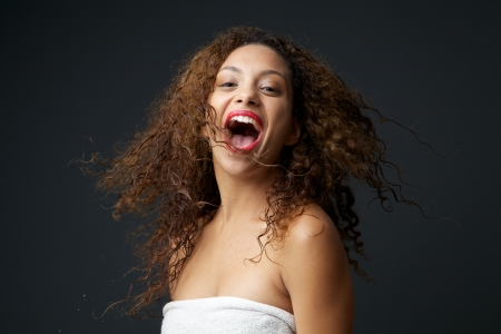 Close up portrait of a fun young carefree woman laughing Stock Photo - 24238510