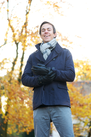 Close up portrait of a smiling man standing outdoors on a cold day photo