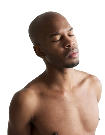 Close up portrait of a young african american man with eyes closed isolated on white photo