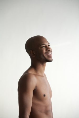 Profile portrait of a smiling black man on white background photo