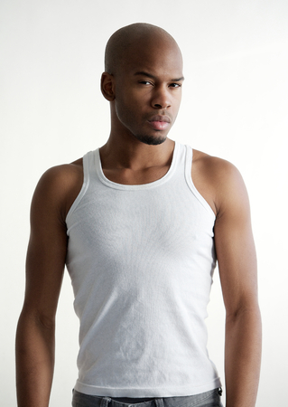 Portrait of a masculine black male fashion model on white background photo