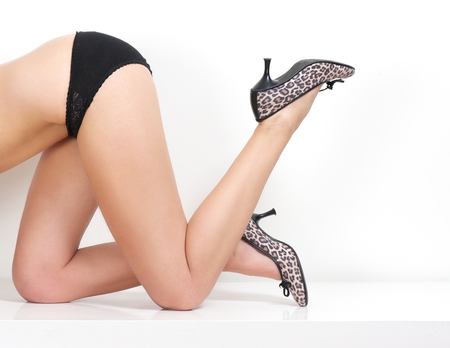 Portrait of a slim female body in underwear with high heel shoes photo