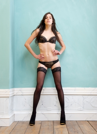 Full body portrait of a slim woman standing in elegant underwear photo