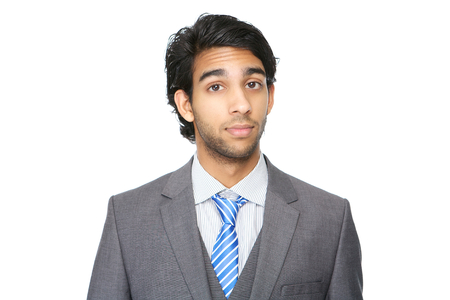 indian business man: Horizontal close up portrait of a young business man isolated on white Stock Photo