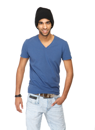 Close up portrait of a casual young man standing against white background with jeans and black hat photo