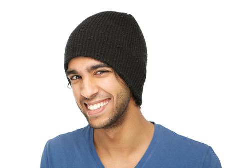 Close up portrait of a funny young man smiling with black hat isolated on white background photo