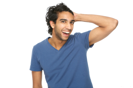 Horizontal portrait of a laughing man with hand in hair isolated on white photo