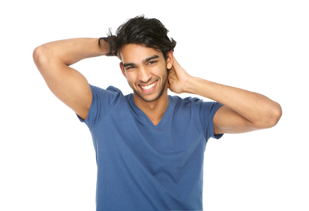 Close up horizontal portrait of a young man laughing with hand in hair  photo