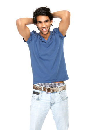 Close up portrait of a young man laughing with hand in hair isolated on white photo